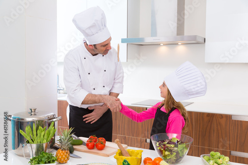 Chef master and junior pupil kid girl handshake
