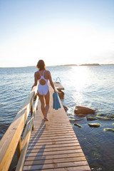 Attractive woman walking on pier