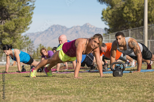 Group Doing Push-Ups with Instructor