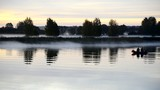 Fishermen at dawn, Lielupe river, Latvia, Europe