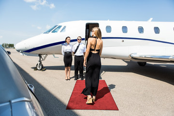 Rich Woman Walking Towards Private Jet