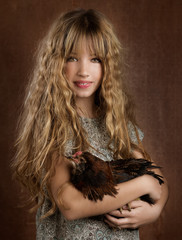 children fashion farmer girl holding hen retro vintage