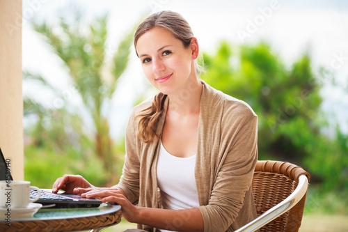 Portrait of a pretty young woman working on her computer