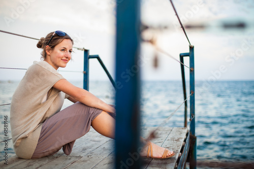 Portrait of a young woman at the seacoast while on vacation