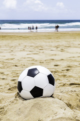 Soccer ball on the sand
