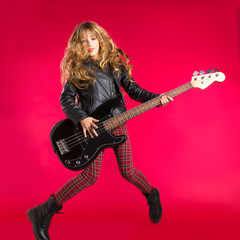 Blond Rock and roll girl with bass guitar jump on red