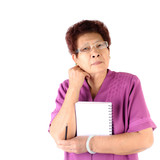 Portrait of a Asian serious senior woman holding notebook and pe