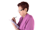 senior woman wearing glasses with holding pencil and notebook