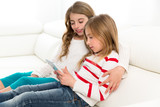 Children sister friends kid girls playing together with tablet p