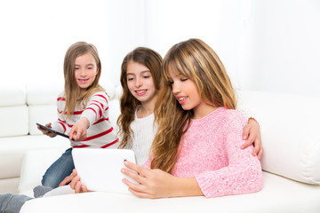 three kid sister friends girls playing together with tablet pc