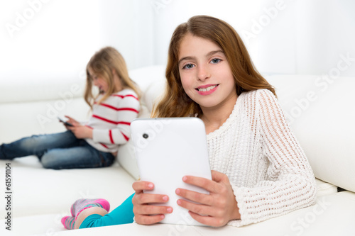 sister friends kid girls playing with tablet pc in sofa