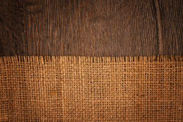 Textured background of a sandy brown burlap cloth