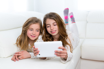 Children friends kid girls playing together with tablet pc