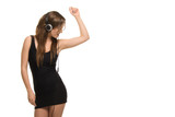 Woman dancing and listening to music form headphones