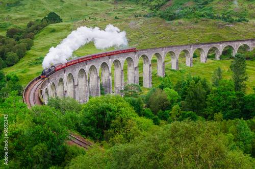 Leinwanddruck Bild Detail of steam train on famous Glenfinnan viaduct, Scotland