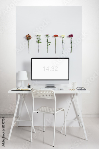 White desk with spring environment.
