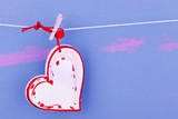red and withe heart on string for blue background