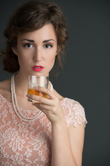 Vintage inspired image of woman holding drink