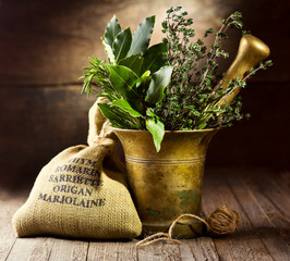 various herbs in mortar