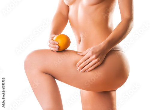 naked girl with orange. cellulite
