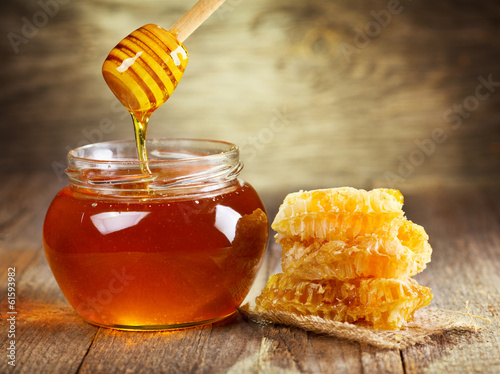 jar of honey with honeycomb - 61593982