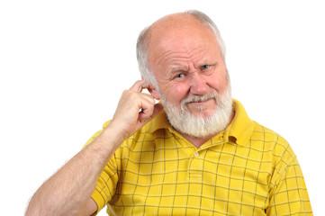 bald senior man picking his ear