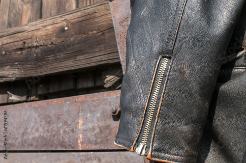 Leather male jacket sleeve on old  railway wagon background