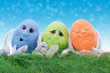 a group of easter eggs sit on grass