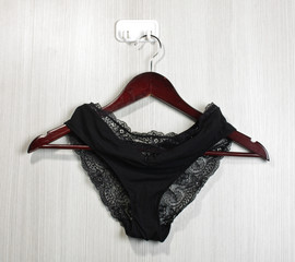 Black sexy underwear hanged on the wall