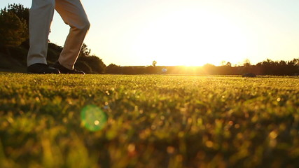 Man Golfing Into Sunset, Slow Motion Shot