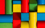 Toys blocks, multicolor wooden bricks, group of colorful squares