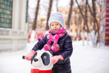 Portrait of adorable little girl on skating rink