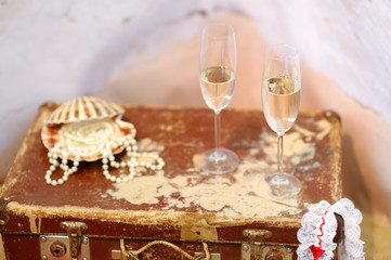 Two champagne glasses and pearls