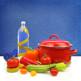 Diet concept with colorful vegetables and a red cooking pot