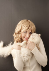Girl holding white Persian cat