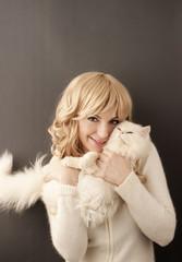 Girl holding white Persian cat