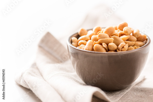 peanuts in a bowl on tablecloth horizontal
