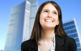 Smiling businesswoman looking up