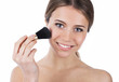 Smiling beauty with makeup brush