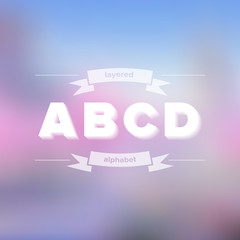 A B C D Flat Layered Alphabet on Blurred Background