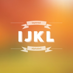 I J K L Flat Layered Alphabet on Blurred Background