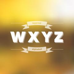 W X Y Z Flat Layered Alphabet on Blurred Background