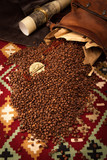 Coffee beans,  African medallion with eagle against a carpet