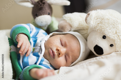 Moments of tranquility: Lovely baby boy sleeping.