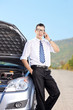Male businessperson talking on phone on an open road