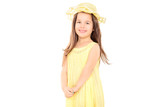 Little girl in yellow dress looking at camera