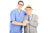 Male healthcare professional and a senior gentleman posing