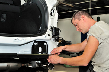 Car mechanic at work.