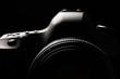Leinwandbild Motiv Professional modern DSLR camera low key image
