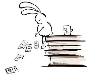 Sleeping rabbit and books